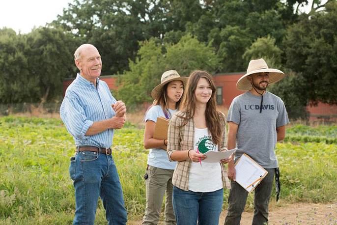 UC Davis Student Farm Director Mark Van Horn and some of his students last year, from left, Alexis Fujii, Mary Laurie and Abraham Cazares.