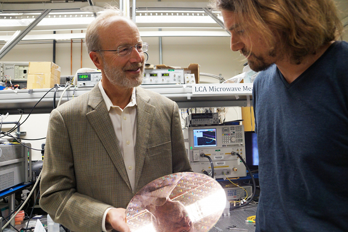 UC Santa Barbara's John Bowers (left) is among 12 UC innovators elected to the National Academy of Inventors.